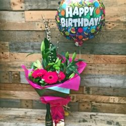 Happy birthday beauty gift set with balloon, chocolates and prosecco